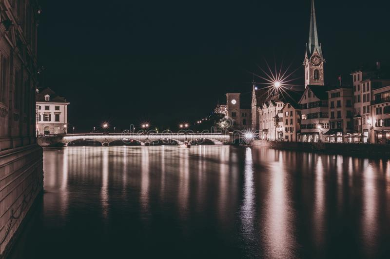 Night view of historic Zurich city center with famous Fraumunster Church royalty free stock photography