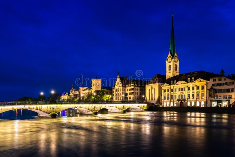 Night view of historic Zurich city center with famous Fraumunster Church and river Limmat in Zurich, Switzerland stock photography
