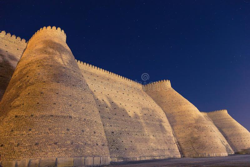 Night view of historical Ark fortess in Bukhara city, Uzbekistan. Wall of the Bukhara Fortress, the Ark. Night view of historical Ark fortess in Bukhara city royalty free stock image
