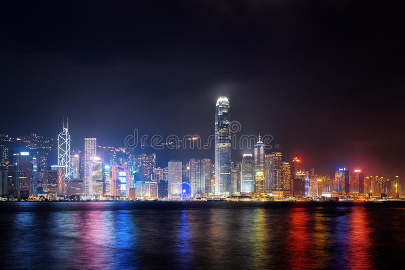 Night view of Hong Kong Island skyline across Victoria harbor. From Kowloon side. Skyscrapers on waterfront in downtown of Hong Kong. Hong Kong is a popular royalty free stock photos