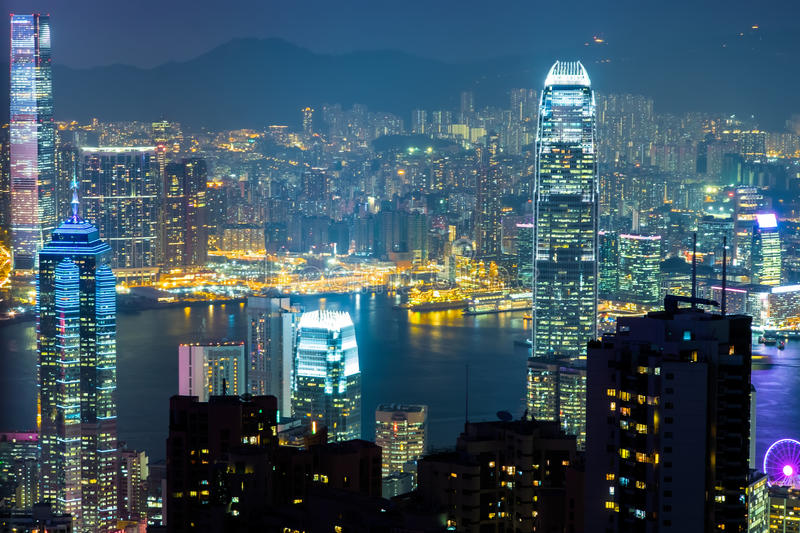 Night view of Hong Kong skyline and Victoria Harbor. Night aerial view panorama of Hong Kong skyline and Victoria Harbor. Travel destinations royalty free stock image