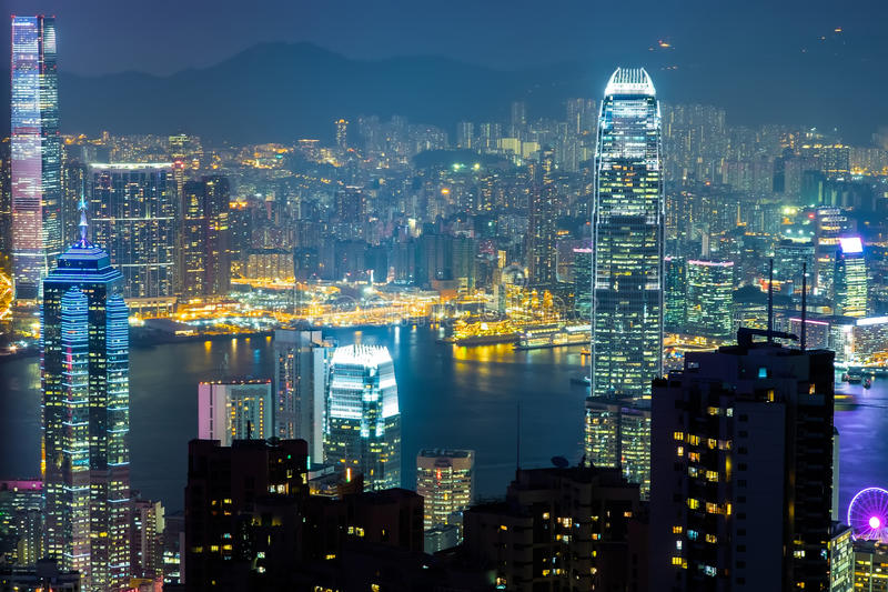 Night view of Hong Kong skyline and Victoria Harbor. Night aerial view panorama of Hong Kong skyline and Victoria Harbor. Travel destinations royalty free stock images