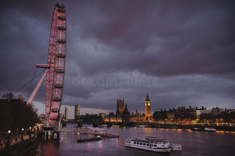 Night view of London Eye and Big Ben stock images
