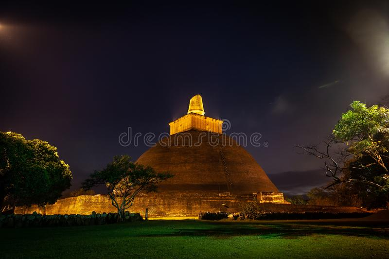 Night view on a huge ancient Jetavanaramaya stupa. Night view on a huge ancient stupa of Jetavanaramaya, in beams of night illumination. The stupa is constructed royalty free stock photography