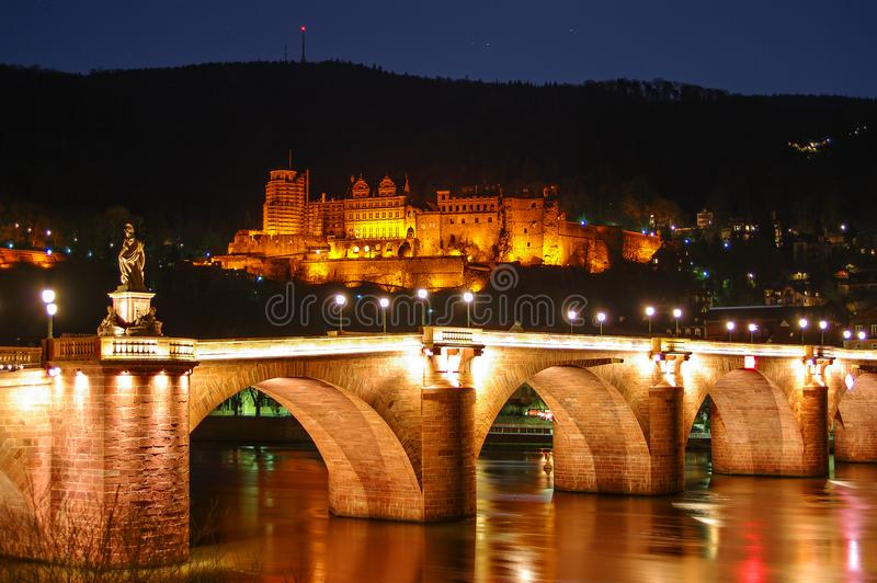 Night view with illumination of old bridge, downtown and castle royalty free stock photography