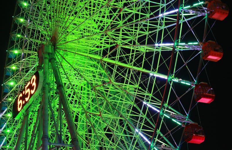 Night view of the illuminations of the Ferris wheel. Night view of the green illuminations of the Ferris wheel of Yokohama, Japan stock photography