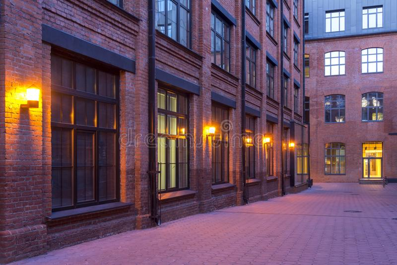 Night view. Industrial building. Modern Loft-style offices located in the old factory building. Red brick houses. Vintage. Buildin stock photo