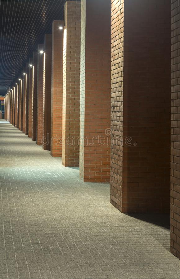 Night view. Industrial building. Office buildings in loft style. Long corridor. Red brick house. Evening. Night view. Industrial building. Office buildings in stock photography