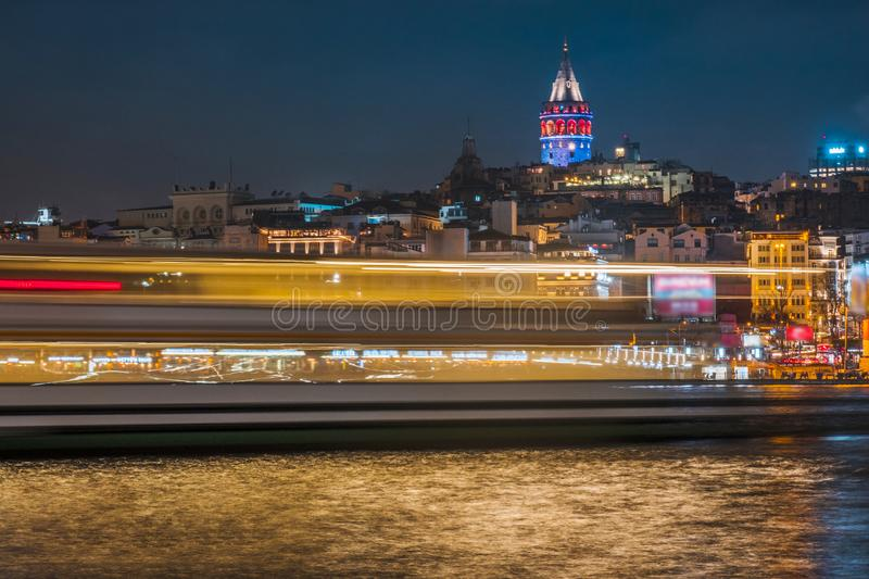 Night view of Istanbul cityscape Galata Tower with floating tourist boats in Bosphorus ,Istanbul Turkey.  royalty free stock images