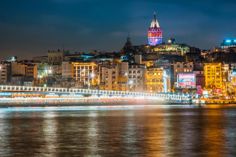 Night view of Istanbul cityscape Galata Tower with floating tourist boats in Bosphorus ,Istanbul Turkey stock photos