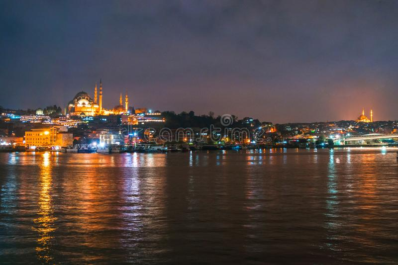 Night view of Istanbul cityscape Suleymaniye Mosque Rustem Pasha Mosque with floating tourist boats in Bosphorus ,Istanbul stock images