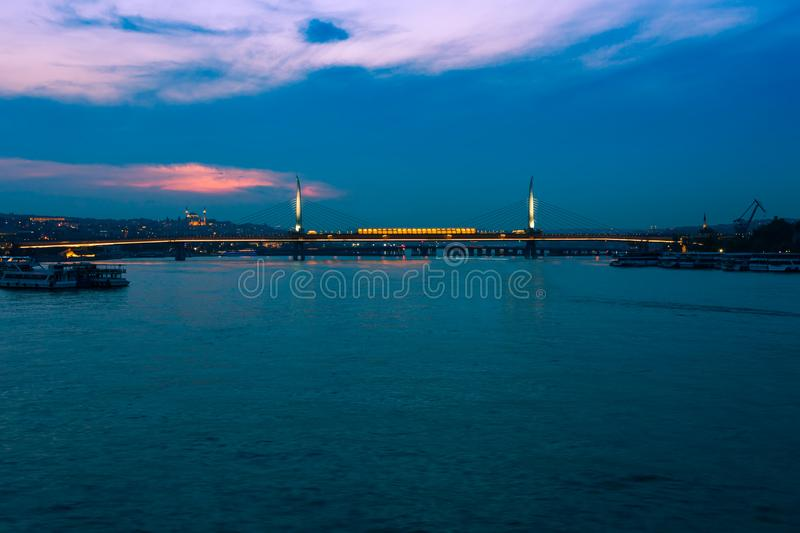 Night view of Istanbul. Panorama cityscape of famous tourist destination Golden Horn bay part of Bosphorus strait. Travel royalty free stock photo