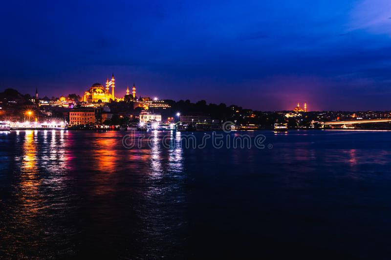 Night view of Istanbul. Panorama cityscape of famous tourist destination Golden Horn bay part of Bosphorus strait. Travel stock photo