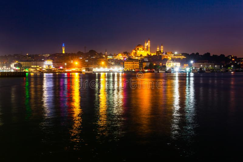 Night view of Istanbul. Panorama cityscape of famous tourist destination Golden Horn bay part of Bosphorus strait. Travel royalty free stock photography
