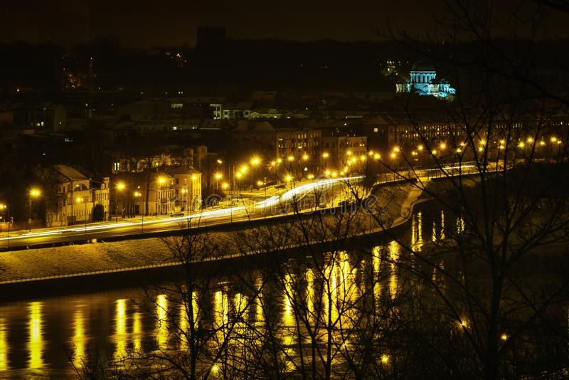 Kaunas downtown aerial night view, Lithuania. Night view of Kaunas cityscape illuminated by the street lights and reflection on the river Nemunas, Kaunas royalty free stock photography