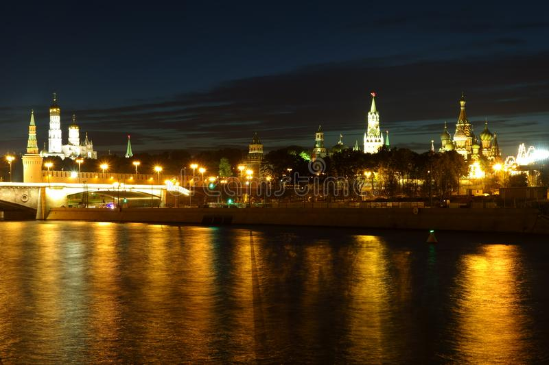 Night view of the Kremlin in the golden reflection in the Moskva-River stock photography