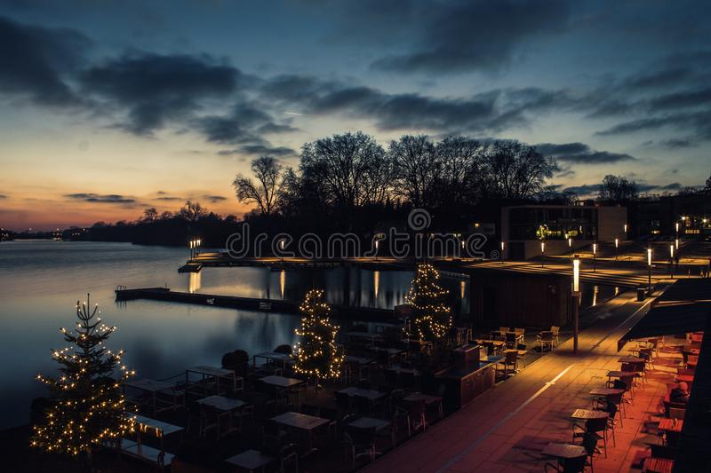 Night view of lake with Holiday lights stock photography