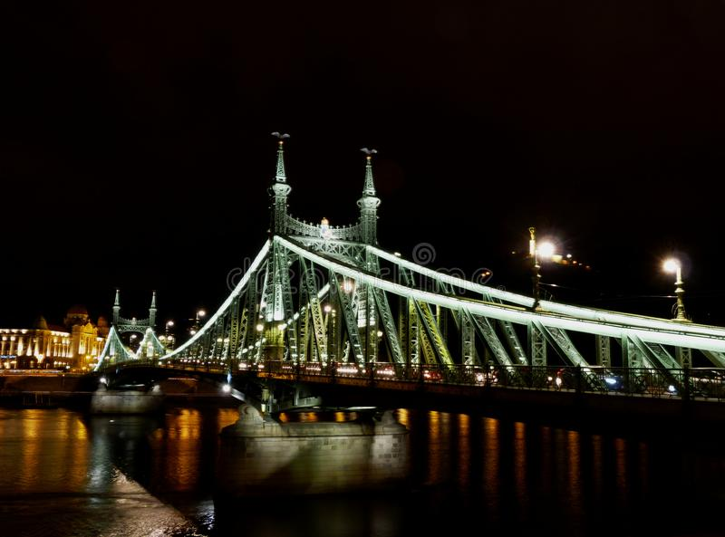 Night view of the Liberty bridge in Budapest with the Gellert Hill above stock images