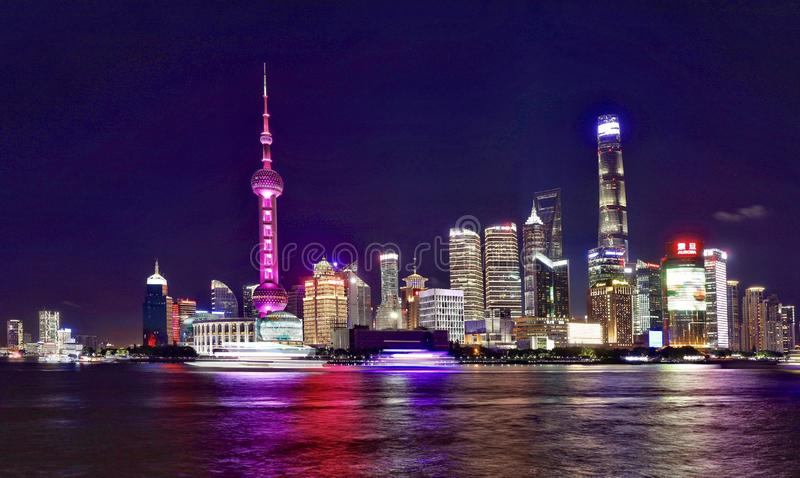 The night view of lujiazui ,pudong,Shanghai. Lujiazui is a locality in Shanghai, a peninsula formed by a bend in the Huangpu River. Since the early 1990s stock images