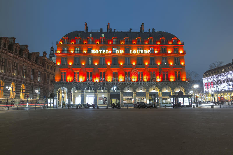 Night view of a magnificient hotel in Paris. Illumination of the louvre hotel neste to the louvre museum in Paris, France stock image