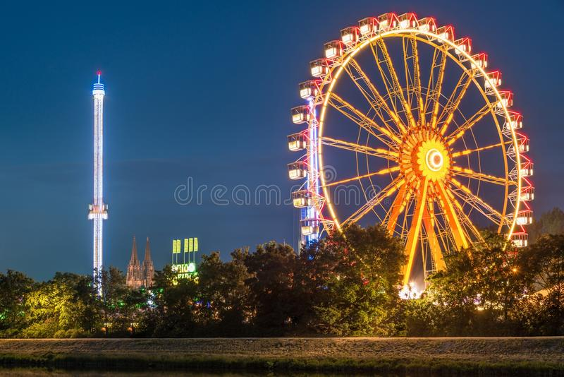Night view of the Maidult with Ferris wheel in Regensburg, Germany.  stock photos