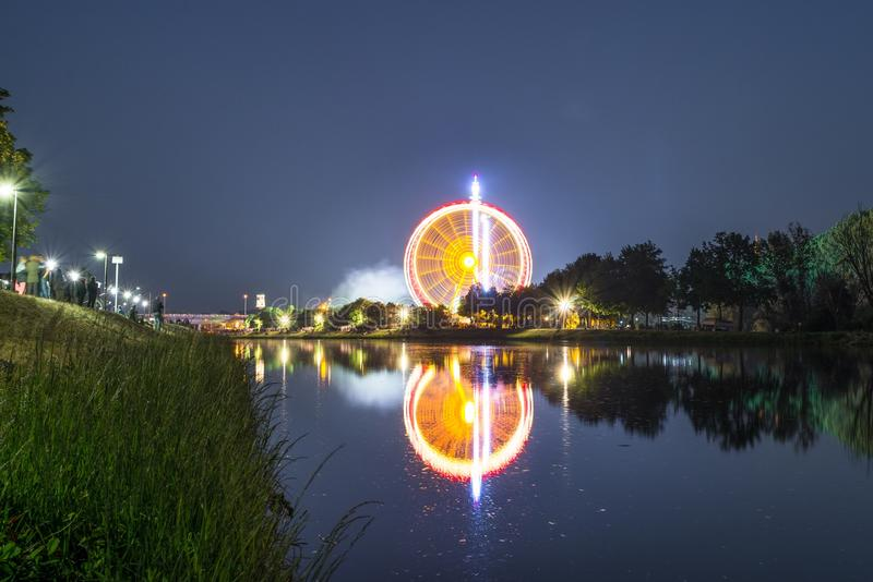 Night view of the Maidult with Ferris wheel in Regensburg, Germany.  royalty free stock image
