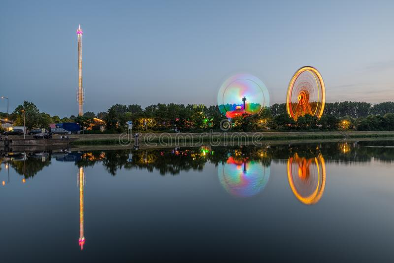 Night view of the Maidult with Ferris wheel in Regensburg, Germany.  stock image