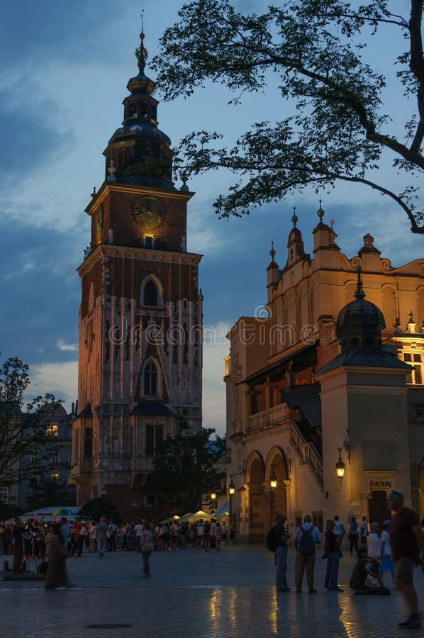 Night view of the Market Square in Krakow, Poland. St. Mary`s Church in a historical part of Krakow stock photos