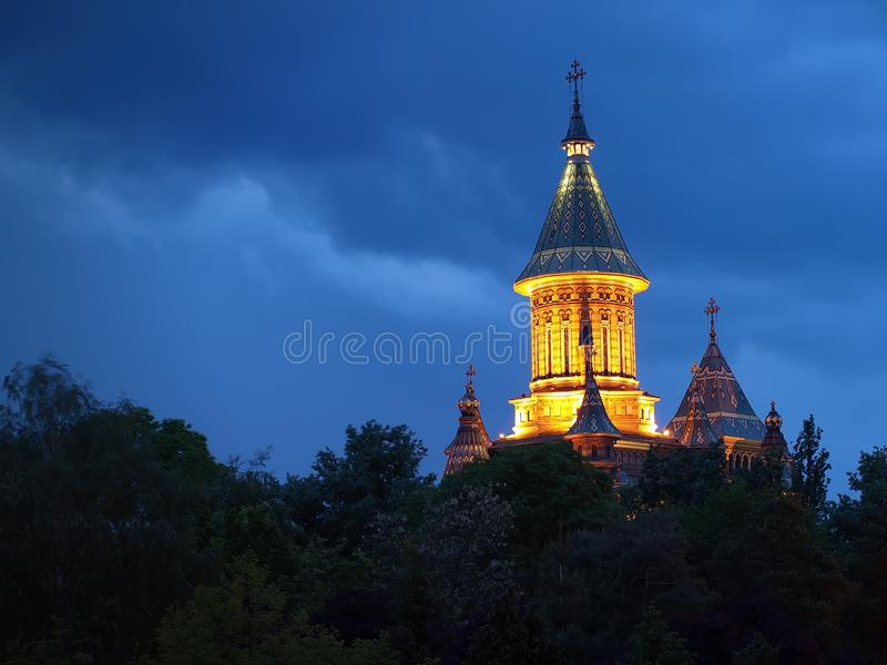 Night view of the Metropolitan Cathedral over the surrounding trees, Timisoara, Romania. Night view of the Metropolitan Cathedral over the surrounding trees in stock photos