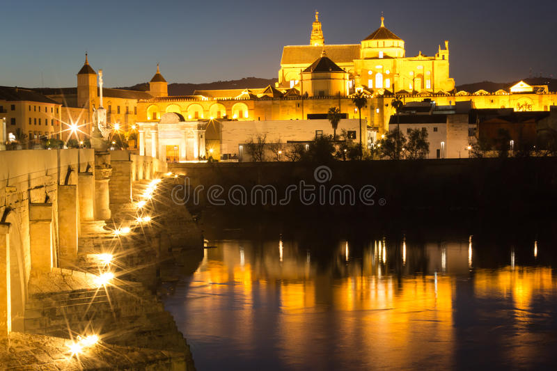 Night view of Mezquita-Catedral and Puente Romano - Mosque-Cathedral and the Roman Bridge in Cordoba, Andalusia, Spain royalty free stock photography