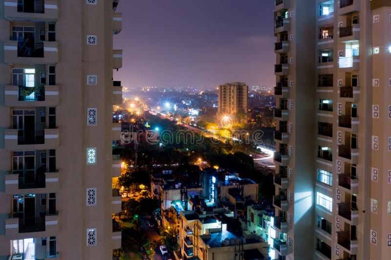 Night view of modern buildings in Noida stock photography