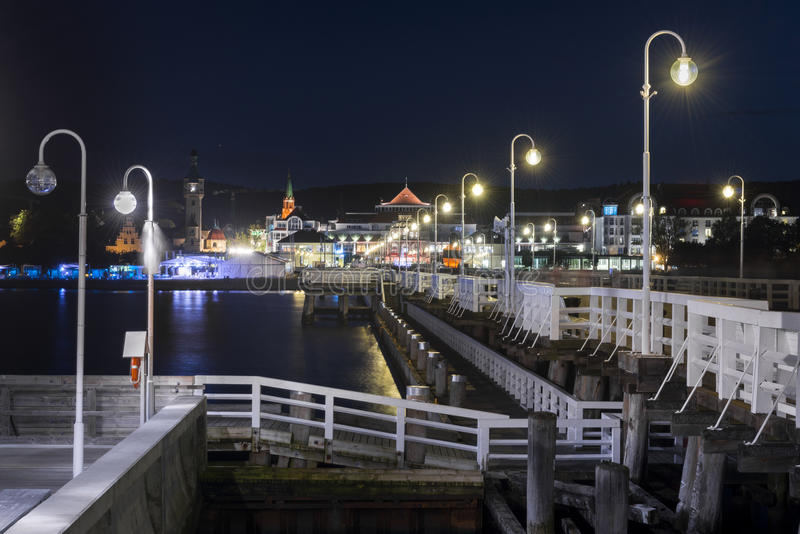 Night view of Molo pier and Sopot city in Poland. Night view of Molo pier and Sopot city at the Baltic sea in Poland royalty free stock photography