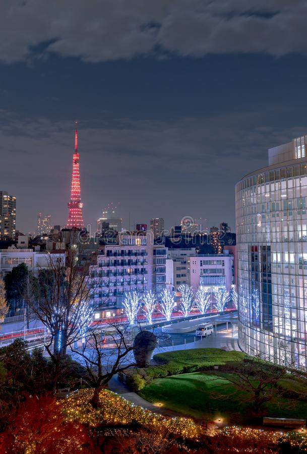 Night view at Mori Garden during winter illumination with Tokyo tower as background, Tokyo, Japan. royalty free stock image