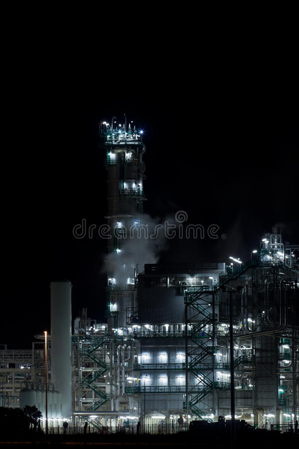 Night View of an Oil Refinery Plant. Vertical shot royalty free stock photo