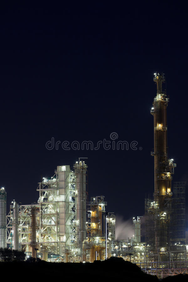 Night View of an Oil Refinery Plant. Vertical shot stock photography
