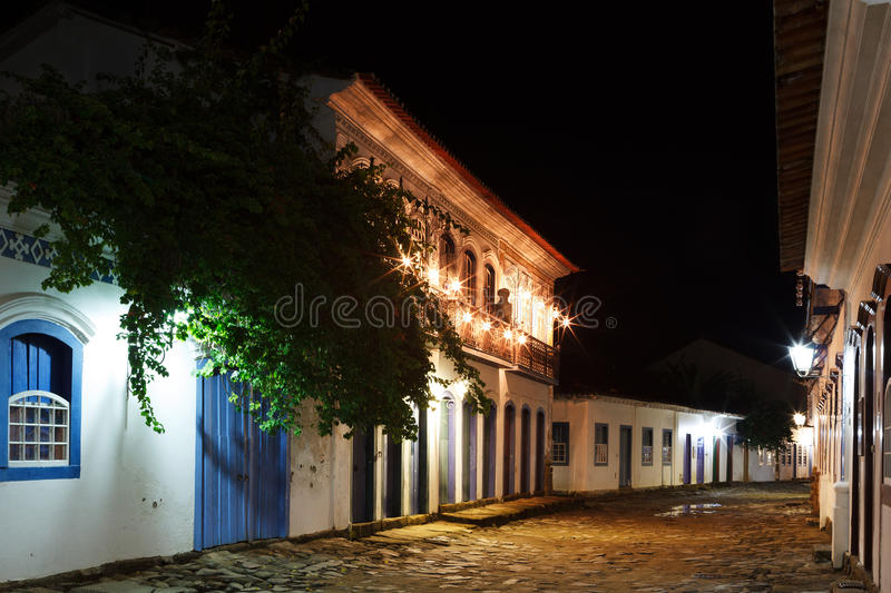 Night view of old colonial houses in historic downtown of Paraty, Brazil. Night view of street and old portuguese colonial houses with lanterns in historic royalty free stock photos