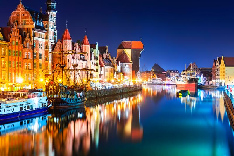 Night view of the Old Town of Gdansk, Poland. Scenic night view of the Old Town pier architecture of Gdansk, Poland at the Motlawa River harbor embankment with stock photo