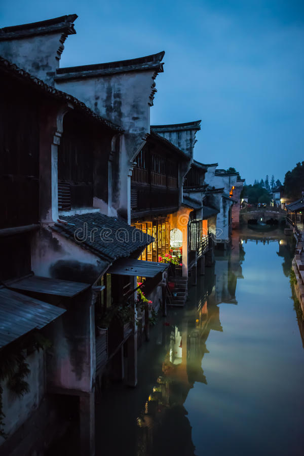 Night view of oriental style buildings besides the river. The night view of oriental style buildings besides the river royalty free stock images