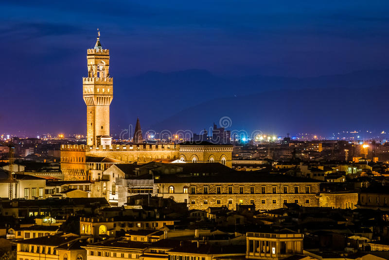 Night view over Palazzo Vecchio at twilight stock photography