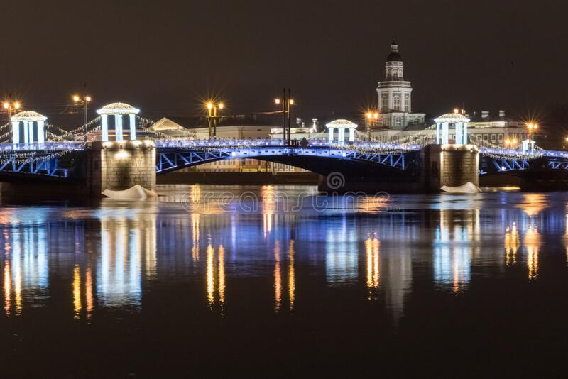 Night view of the Palace Bridge decorated with festive lights for the New Year. Sankt-Peterburg, Russia.  royalty free stock image