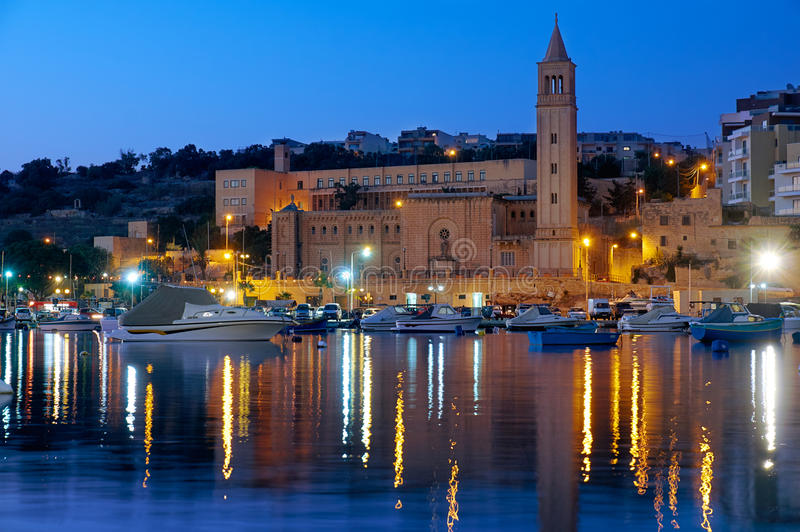 The night view of parish church of St. Anna over the Marsaskala. The night view of Marsaskala parish church of Sant Anna St. Anne over the Marsaskala Creek with royalty free stock photos