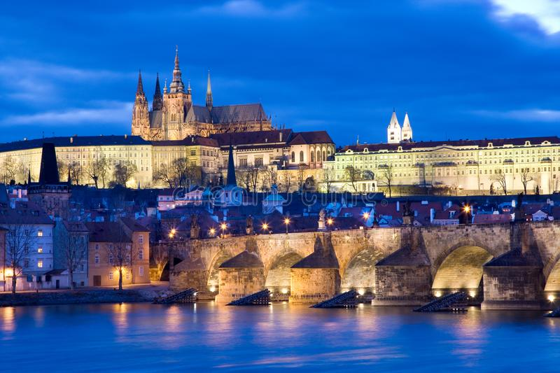 Prague castle and Charles bridge over Moldau river, Lesser town, Prague (UNESCO), Czech republic. Night view of Prague castle with st Vitus cathedral and gothic stock photography
