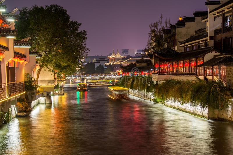 Night view of Qinhuai River and historic buildings at the riverbank near Fuzimiao Confucius Temple in Nanjing, China.  stock photography