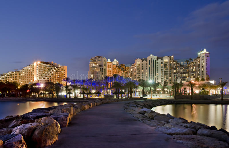 Night view on resort hotels, Eilat, Israel. The shot was taken from the northern beach of Eilat city - famous resort and recreation city in Israel stock photography