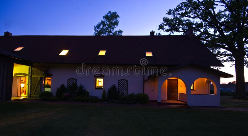 Night view of a rural house in Poland royalty free stock photos