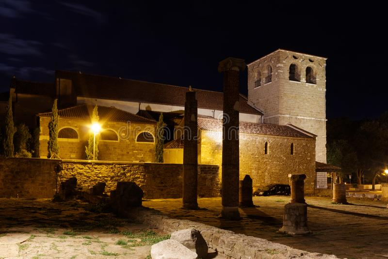 San Giusto Cathedral and Roman Ruins in Trieste at Night. Night view of the San Giusto cathedral and the Roman forum ruins in Trieste, Italy royalty free stock images