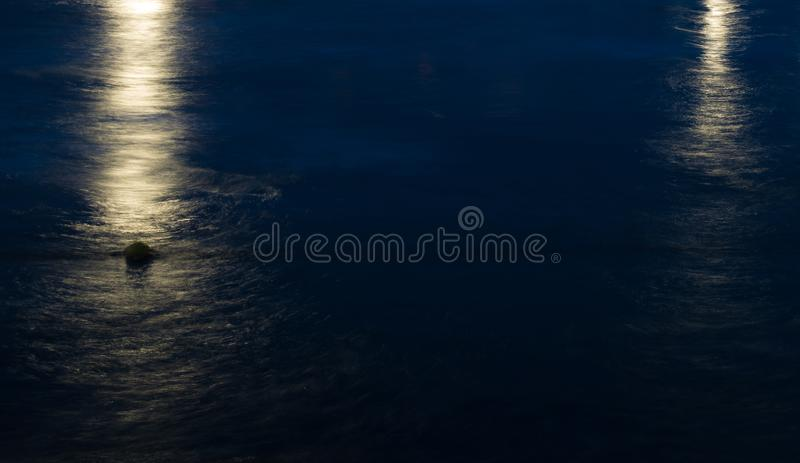 Night view of the sea waves. Long exposure image stock images