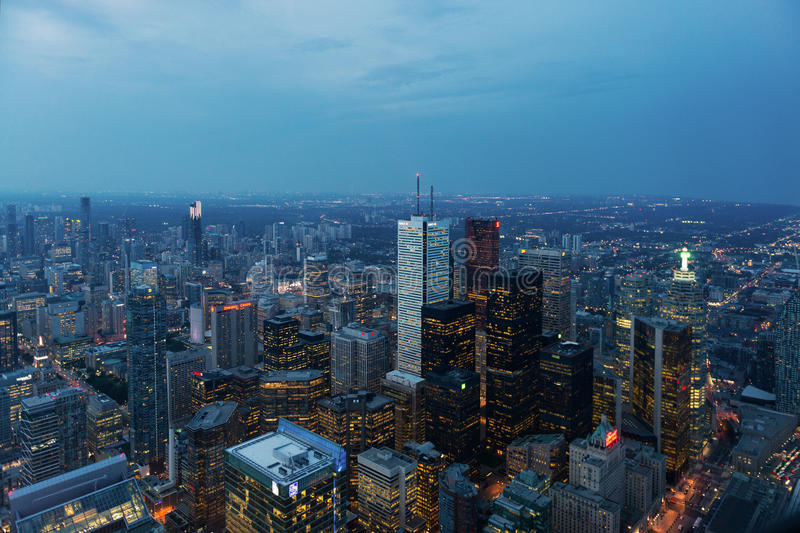 Night view of skyscrapers and office buildings in Downtown Toronto. Toronto, Canada - September 9, 2015: Aerial view of illuminated skyscrapers and office stock images