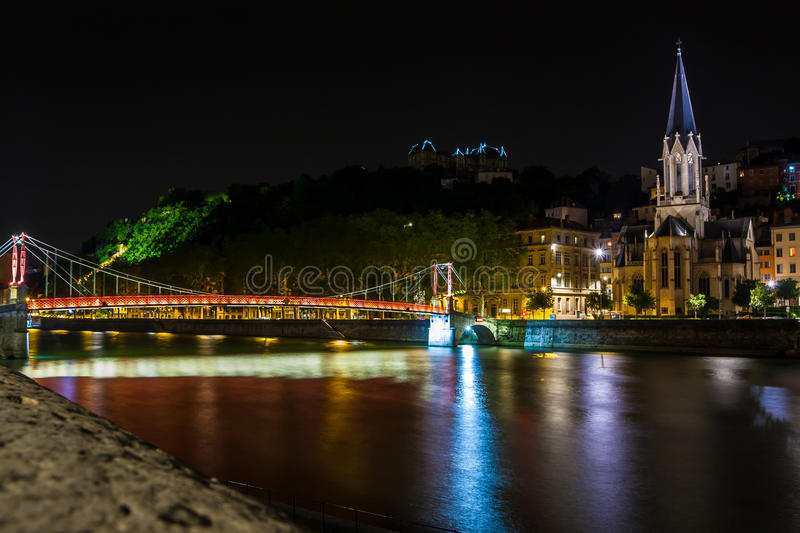 Night view from St Georges footbridge in Lyon city with Fourviere cathedral. France stock photo