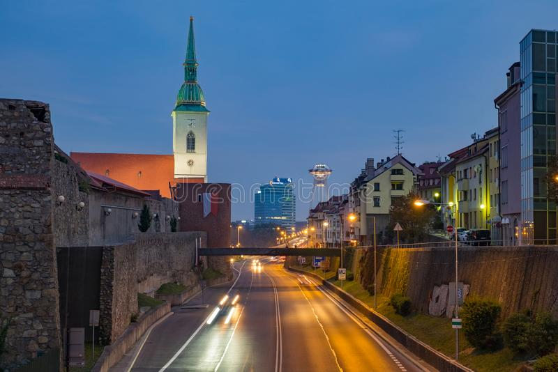 Night view of the St. Martin`s Cathedral and futuristic bridge SNP stock image